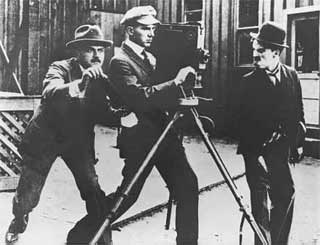 Chaplin razzing the director